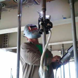 Welder working on a section of pipe